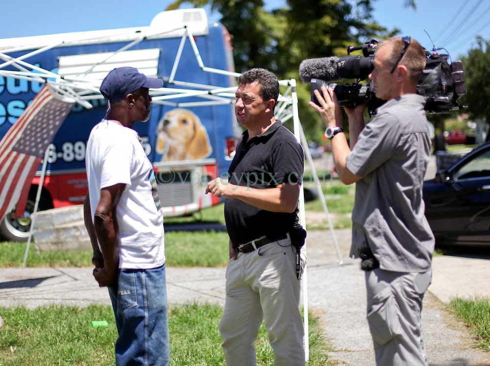 26 August 2015. New Orleans, Louisiana. <br /> Hurricane Katrina revisited. <br /> The media comes to town to investigate how the city is doing 10 years after the storm. Members of the BBC interview Robert Green, a hurricane Katrina survivor who lost his home, his grand daughter and mother to the storm.<br /> Photo credit&copy;; Charlie Varley/varleypix.com.