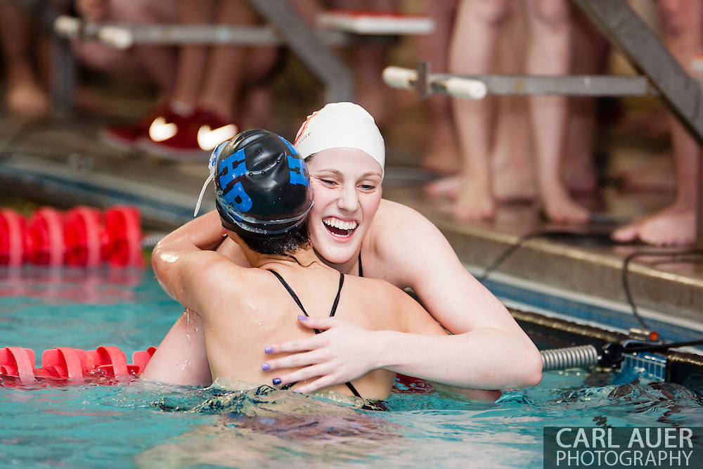 January 8, 2013: Olympic Gold Medalist and Regis Jesuit High School senior Missy Franklin congratulates one of her opponents in her return to the pool after the London Olympics during the swim meet against Highlands Ranch at Regis Jesuit High School.