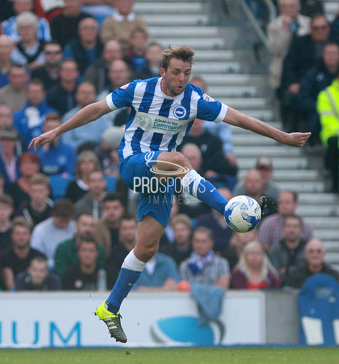 Brighton central midfielder Dale Stephens wins possession in midfield during the Sky Bet Championship match between Brighton and Hove Albion and Cardiff City at the American Express Community Stadium, Brighton and Hove, England on 3 October 2015. Photo by Bennett Dean.