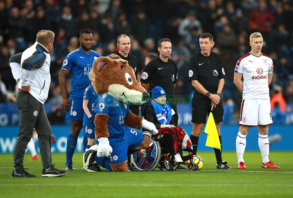 "Leicester City's mascot Filbert Fox with match officials, Leicester City's Wes Morgan (left) and Burnley's Ben Mee (right) during the Premier League match at the King Power Stadium, Leicester. PRESS ASSOCIATION Photo Picture date: Saturday December 2, 2017. See PA story SOCCER Leicester. Photo credit should read: Mike Egerton/PA Wire. RESTRICTIONS: EDITORIAL USE ONLY No use with unauthorised audio, video, data, fixture lists, club/league logos or ""live"" services. Online in-match use limited to 75 images, no video emulation. No use in betting, games or single club/league/player publications."