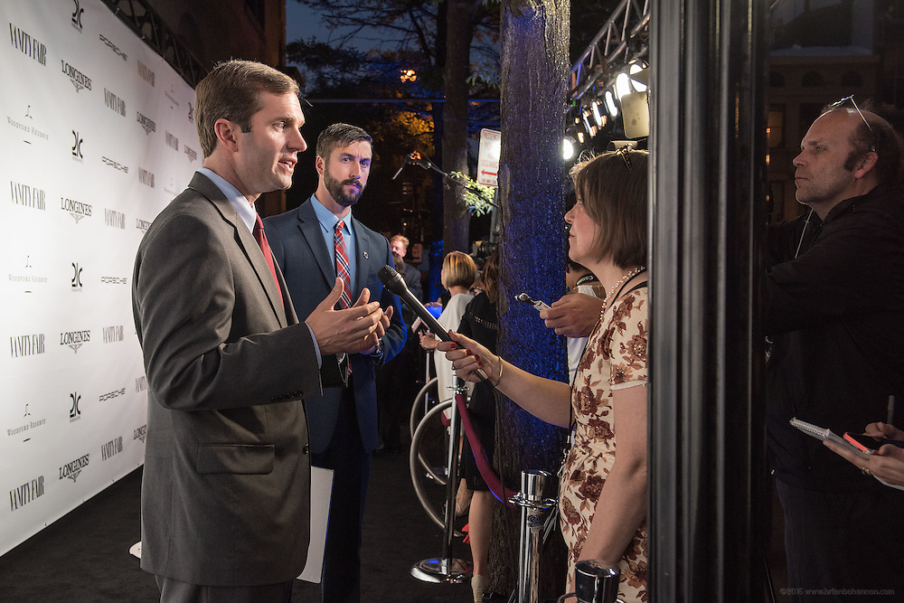 Kentucky Attorney General Andy Beshear speaks Couier-Journal reporter Elizabeth Kramer and photographer Marty Pearl on the black carpet at the Vanity Fair Derby party at 21c Museum Hotel. May 6, 2016