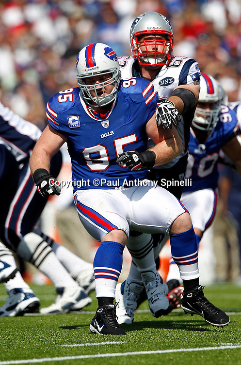 Buffalo Bills nose tackle Kyle Williams (95) makes a move during the NFL week 3 football game against the New England Patriots on Sunday, September 25, 2011 in Orchard Park, New York. The Bills won the game 34-31. ©Paul Anthony Spinelli