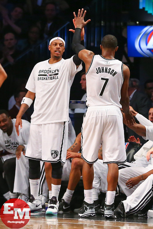 Apr 1, 2014; Brooklyn, NY, USA; Brooklyn Nets guard Joe Johnson (7) is congratulated by Brooklyn Nets forward Paul Pierce (34) during the fourth quarter at Barclays Center. The Nets defeated the Rockets 105-96.