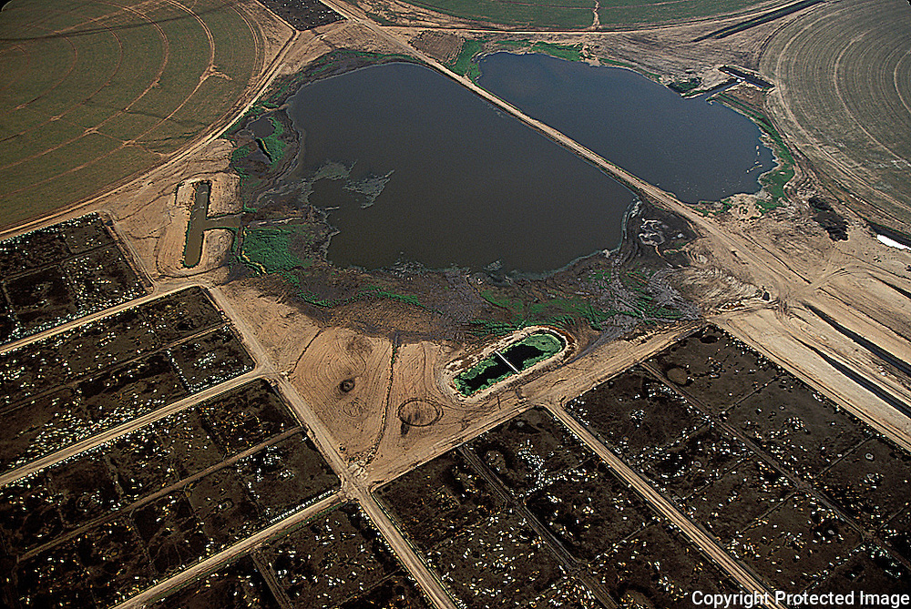 Playa surrounded by feedlot; Texas;  aerial photo