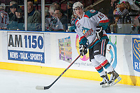 KELOWNA, CANADA - DECEMBER 27: Tate Coughlin #15 of the Kelowna Rockets skates during warm up against the Kamloops Blazers on December 27, 2013 at Prospera Place in Kelowna, British Columbia, Canada.   (Photo by Marissa Baecker/Shoot the Breeze)  ***  Local Caption  ***