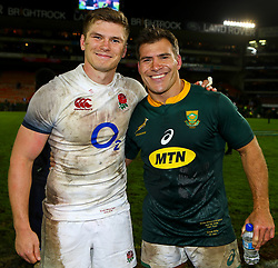 Owen Farrell (captain) of England with Schalk Brits of South Africa- Mandatory by-line: Steve Haag/JMP - 23/06/2018 - RUGBY - DHL Newlands Stadium - Cape Town, South Africa - South Africa v England 3rd Test Match, South Africa Tour
