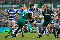 Francois Louw of Bath Rugby looks to offload the ball after being tackled by Jordan Crane of Leicester Tigers - Photo mandatory by-line: Patrick Khachfe/JMP - Mobile: 07966 386802 04/01/2015 - SPORT - RUGBY UNION - Leicester - Welford Road - Leicester Tigers v Bath Rugby - Aviva Premiership