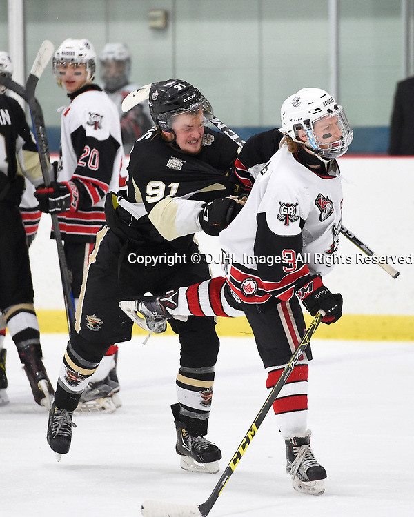 GEORGETOWN, ON - APR 18,  2017: Ontario Junior Hockey League, Championship Series. Georgetown Raiders vs the Trenton Golden Hawks in Game 3 of the Buckland Cup Final.  Mac Lewis #91 of the Trenton Golden Hawks makes the hit on Jordan Crocker #9 of the Georgetown Raiders during the third period.<br /> (Photo by Andy Corneau / OJHL Images)