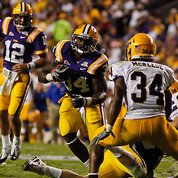 October 16, 2010; Baton Rouge, LA, USA; LSU Tigers running back Stevan Ridley (34) runs as McNeese State Cowboys safety Malcolm Bronson (34) pursues during the first half at Tiger Stadium.  Mandatory Credit: Derick E. Hingle