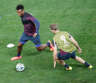 Daniel Sturridge of England (L) goes past Jordan Henderson of England during the England training session at Arena Corinthians, Sao Paulo, Brazil, on the eve of their World Cup 2014 Group D match against Uruguay.<br /> Picture by Andrew Tobin/Focus Images Ltd +44 7710 761829<br /> 18/06/2014