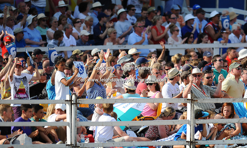 "The crowd celebrate in the soaring 30 degree heat during the Friends Life T20 between Essex ""Eagles"" v Sussex ""Sharks"". at the Essex County Cricket Ground on the 14th July 2013. Credit: © Leigh Dawney Photography. Self Billing where applicable. Tel: 07812 790920"