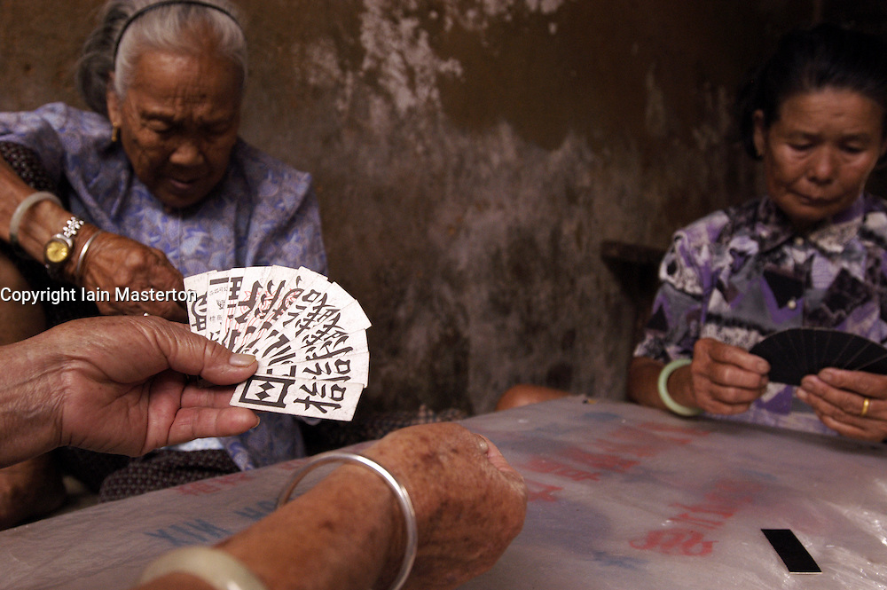 Old Chinese Hakka women playing cards in a village in Guangdong Provinve China