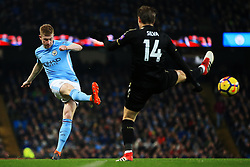 Kevin De Bruyne of Manchester City crosses under pressure from Adrien Silva of Leicester City - Mandatory by-line: Matt McNulty/JMP - 10/02/2018 - FOOTBALL - Etihad Stadium - Manchester, England - Manchester City v Leicester City - Premier League