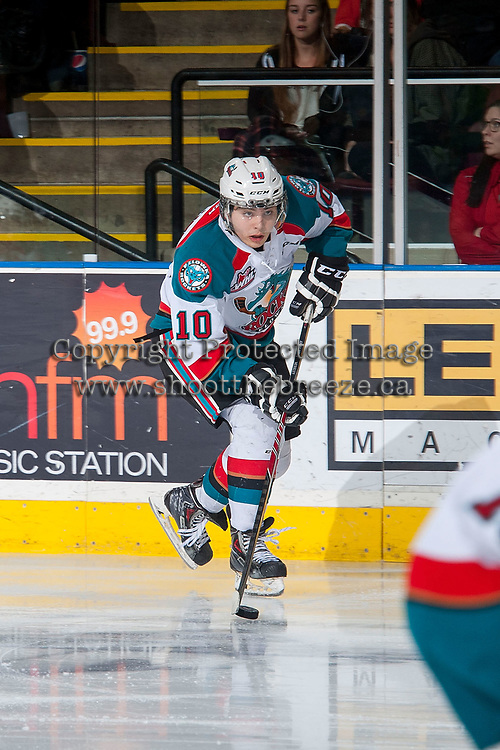 KELOWNA, CANADA - MARCH 28: Nick Merkley #10 of Kelowna Rockets skates with the puck up the ice against the Tri-City Americans on March 28, 2015 at Prospera Place in Kelowna, British Columbia, Canada.  (Photo by Marissa Baecker/Getty Images)  *** Local Caption *** Nick Merkley;