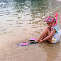 USA, Hawaii, Kohala Coast. Young girl getting ready to snorkel at Hapuna beach. Model-released.
