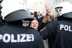 """11.06.2016, Wien, AUT, Demonstration der Identitären Bewegung Österreich mit diversen Gegendemonstrationen. im Bild Gegendemonstrantin // Counter demonstrator during demonstration of the right group """"Identitaeren"""" and left-wing counter demonstrations in Vienna, Austria on 2016/06/11. EXPA Pictures © 2016, PhotoCredit: EXPA/ Michael Gruber"""
