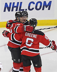 Feb 16; Newark, NJ, USA; The New Jersey Devils celebrate a goal by New Jersey Devils left wing Brian Rolston (12) during the third period at the Prudential Center. The Devils defeated the Hurricanes 3-2.