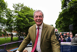 © Licensed to London News Pictures. 25/05/2016. Chapeltown, UK. Nigel Farage and the UKIP Referendum bus tour Chapeltown in Chapeltown, South Yorkshire. The party's purple open top battle bus is touring the country in the run up to the EU referendum. There is just a month to go until the UK's referendum on it's membership of the European Union. Poll stations will open their doors on Thursday 23 June. Photo credit : Ian Hinchliffe/LNP