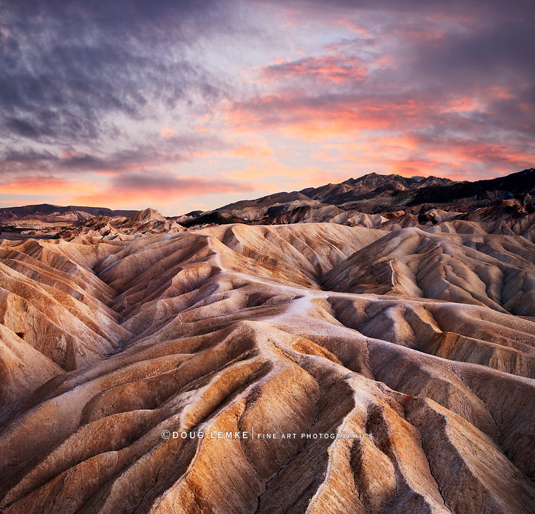 Stormy Sunset Skies Over Heavily Eroded Ridges At Zabriskie Point, Death Valley National Park, California, USA