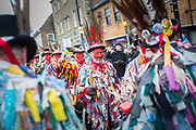 UNITED KINGDOM, Whittlesey: Straw Bear Festival. Morris dancers perform on the streets of Whittlesey during the Straw Bear festival this weekend. The three day festival, which originated in 1882, consists of traditional Molly, Morris, Clog and Sword dancing as well as parading a large straw character known as 'The Bear' through the town. Rick Findler  / Story Picture Agency