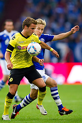 23.07.2011, Veltins arena, Gelsenkirchen, GER, Supercup, FC Schalke 04 vs. Borussia Dortmund, im Bild Zweikampf Mario Goetze (#11 Dortmund) - Lewis Holtby (#10 Schalke) // during the match FC Schalke 04 vs. Borussia Dortmund at Veltins arena 2011/07/23    EXPA Pictures © 2011, PhotoCredit: EXPA/ nph/  Kurth       ****** out of GER / CRO  / BEL ******