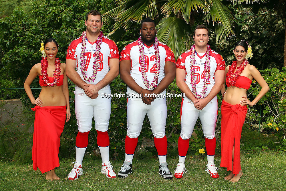 KAPOLEI, HI - FEBRUARY 06: Hula girls flank members of the AFC All-Stars (L-R) Joe Thomas #73, Shaun Rogers #92, and Ryan Pontbriand #64 of the Cleveland Browns at team photo day the week of the 2009 NFL Pro Bowl at the Ihilani Resort and Spa on February 6, 2009 in Kapolei, Hawaii. ©Paul Anthony Spinelli *** Local Caption *** Joe Thomas;Shaun Rogers;Ryan Pontbriand