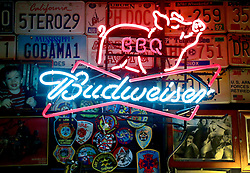 19 June 2013. Dreamland BBQ restaurant, Jerusalem Heights, Tuscaloosa, Alabama.<br /> Budweiser neon sign on the wall at Dreamland BBQ restaurant. Founded in 1958 by John 'Big Dady' Bishop. Serving legendary ribs and other BBQ delicacies for over 50 years.  <br /> Photo; Charlie Varley