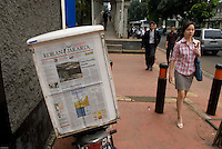 Koran Jakarta, a business newspaper, front page with a woman on her way to work in Jakarta golden triangle.