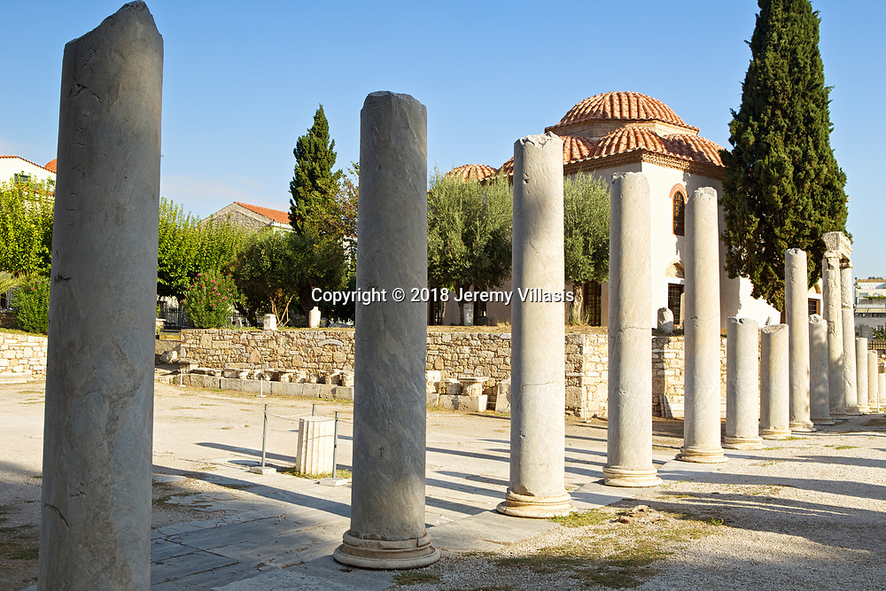 A row of ancient columns and the Fethiye Mosque in the Roman Agora of Athens.