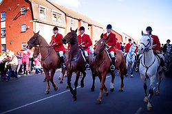 Fox hunters ride through the town to demonstrate against the introduction of the hunting ban, Melton Mowbray, Leicestershire, England, UK.