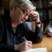 "October 7, 2013 - New Yor, NY : Playwright Richard Nelson, whose four-play cycle the ""Apple Family Plays"" are set in his hometown of Rhinebeck in the Hudson Valley, works in his home office on Monday afternoon. CREDIT: Karsten Moran for The New York Times"