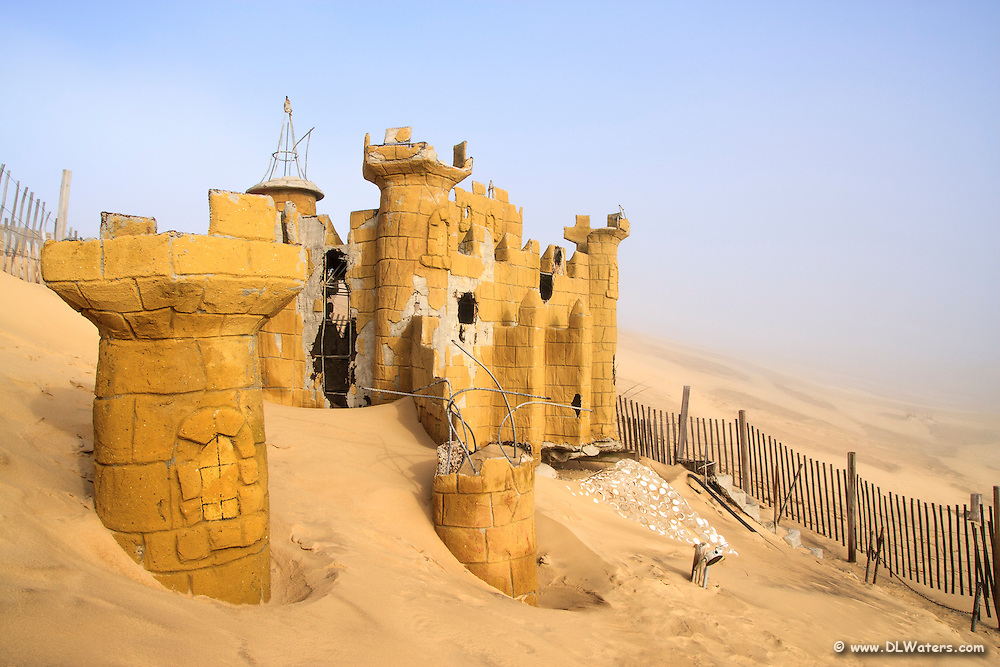 This is what remained of a putt putt golf course at Jockey's Ridge State Park. Over the years blowing sand has completely covered this castle. It has been slowly uncovered over the past 10 years and reburied.
