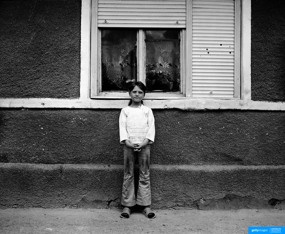 A young girl poses in the small rural town of Rupea in the heart of Transylyania,  Romania. Photo Tim Clayton..Romania entered the European Economic Community in January 2007, signaling a fresh exodus of the work force as many Romanians fled the country in search of a better life. Sadly many have not found the employment sought and Romanian communities camped in European cities are making headlines for all the wrong reasons...In a nation recovering from communist rule from 1947 to 1989 and a decade of economic instability and decline that followed, it is estimated Romania has lost between 2.0 and 2.5 million of it's workforce since the end of communist rule. Considering Romanian's population is estimated at 22 million, this is about 10% of the Country's population...Life goes on as normal for those who have remained in Romania. In a country steeped in history and culture there has been little or no change in age old traditions, life is personified in the rural communities where a third of Romanian's population is employed in agriculture and primary production, one of the highest in Europe.