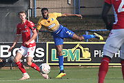 Hayden White of Mansfield Town (2) sends in a corss watched by Lewis Page of Charlton Athletic (3) during the The FA Cup match between Mansfield Town and Charlton Athletic at the One Call Stadium, Mansfield, England on 11 November 2018.