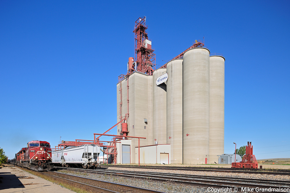 Inland grain terminal and train with railway tracks<br /> Maple Creek<br /> Saskatchewan<br /> Canada