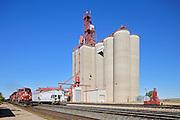 Inland grain terminal and train with railway tracks<br /> Maple Creek<br /> Saskatchewan<br /> Canada