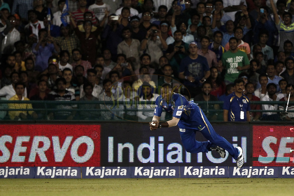 Kieron Pollard of the Mumbai Indians  take the catch of Ahmed Shehzad of the LAHORE LIONS during the qualifier 2 match of the Oppo Champions League Twenty20 between the Mumbai Indians and the Lahore Lions held at the Chhattisgarh International Cricket Stadium, Raipur, India on the 13th September 2014<br /> <br /> Photo by:  Deepak Malik / Sportzpics/ CLT20<br /> <br /> <br /> Image use is subject to the terms and conditions as laid out by the BCCI/ CLT20.  The terms and conditions can be downloaded here:<br /> <br /> <br /> http://sportzpics.photoshelter.com/gallery/CLT20-Image-Terms-and-Conditions-2014/G0000IfNJn535VPU/C0000QhhKadWcjYs