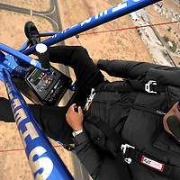 070913  Adron Gardner/Independent<br /> <br /> Cibola County Sheriff John Valdez pilots a Silver Lining Aviation powered parachute over the Grants-Milan Municipal Airport Tuesday.