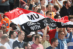 Manchester United fans celebrate - Mandatory by-line: Jack Phillips/JMP - 07/05/2016 - FOOTBALL - Carrow Road - Norwich, England - Norwich City v Manchester United - Barclays Premier League