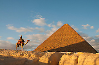 Camel and rider near the Great Pyramid in Giza, Egypt.