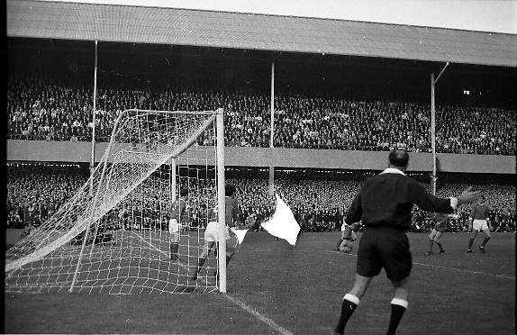 Waterford FC vs Manchester United at Lansdowne Road..1968..18.09.1968..09.18.1968..18th September 1968..Waterford FC as champions of the league of Ireland drew Manchester United, the European Champions,in the first round of this years competition.The Waterford team was as follows: Peter Thomas, Peter Bryan, Noel Griffin, Vinny Maguire, Jackie Morley, Jimmy McGeough, Al Casey, Alfie Hale, John O'Neill, Shamie Coad and Johnny Matthews. Manchester United won the tie 3 -1 with Denis Law being the man of the match..Alex Stepney,Tony Dunne,Francis Burns,Paddy Crerand,.Bill Foulkes,Nobby Stiles,George Best,Denis Law,.Bobby Charlton,David Sadler,Brian Kidd were the starting eleven for United...Image shows Manchester United defending a corner from Waterford FC.