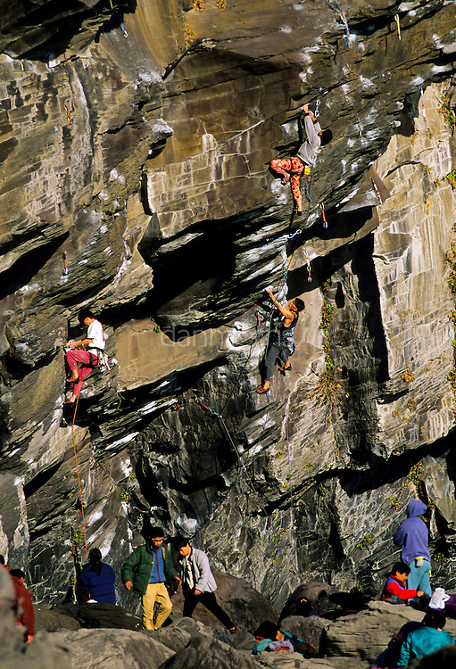 Crowded rock climbing on sea cliffs of Jogasaki