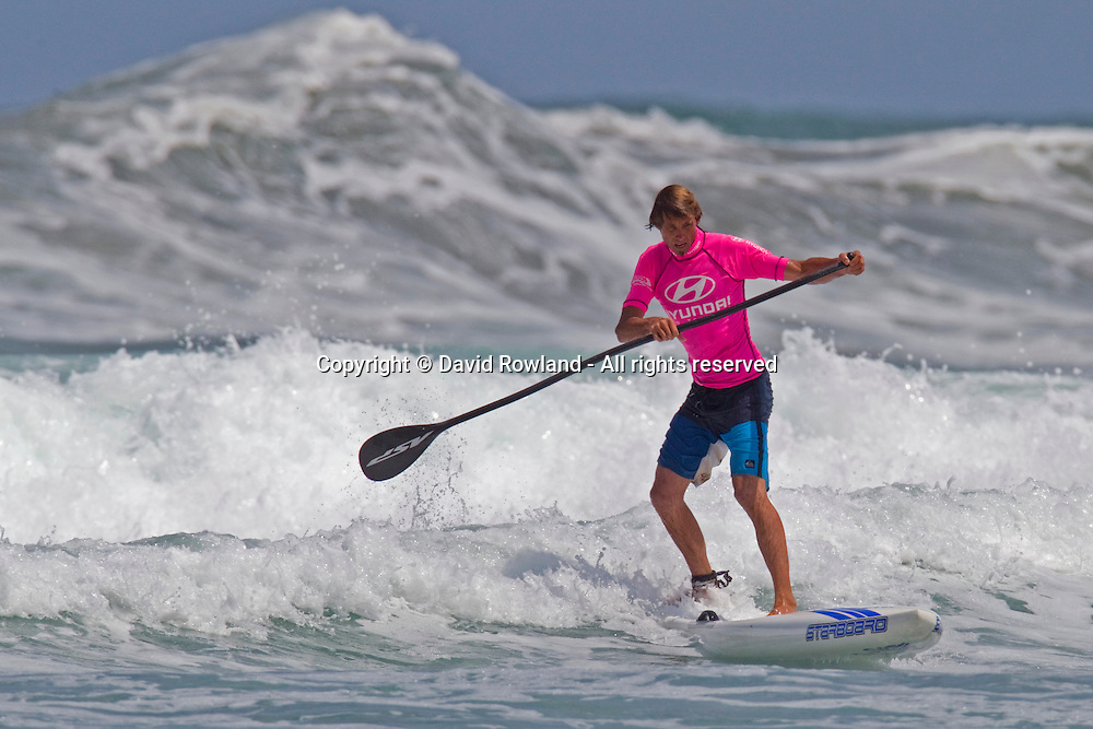 A paddleboarder at the 2013 New Zealand National Surfing Championships, Piha, Auckland, New Zealand,Saturday, January 19, 2013. Photo: David Rowland/PHOTOSPORT