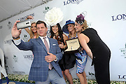 Fashion contest judge Tom Murro, contributor at Huffington Post, takes a selfie with Ashley Lauren Kerr, center, of Maine, and fellow judges Jessielyn Palumbo, left, Miss New Jersey USA, Amy Figueroa, second right, of Longines, and Mallory Hagan, right, Miss America 2013, after Kerr was named winner of the Longines Most Elegant Woman fashion contest, Saturday, June 11, 2016, at Belmont Park in Elmont, NY.  Longines, the Swiss watchmaker known for its elegant timepieces, is the Official Watch and Timekeeper of the 148th running of the Belmont Stakes. (Diane Bondareff/AP Images for Longines)