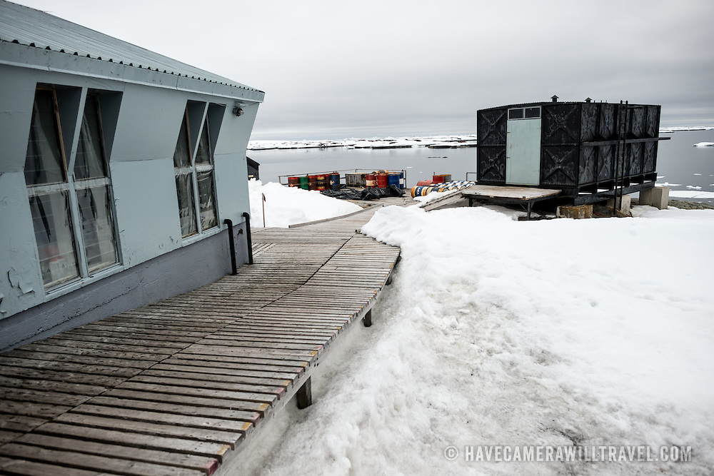 Buildings at the Vernadsky Research Base in Antarctica. At left is the main generator complex, with the dock in the center of frame. Originally established by the British first as Base F in the British Falkland Islands Dependencies and later as Faraday Station, it was transferred to the Ukraine in 1996 and renamed Vernadsky Research Base after Soviet mineralogist Vladimir Vernadsky.