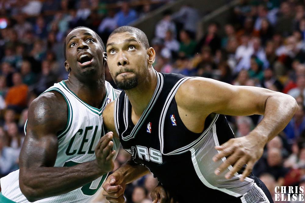 21 November 2012: Boston Celtics power forward Brandon Bass (30) vies for the rebound with San Antonio Spurs power forward Tim Duncan (21) during the San Antonio Spurs 112-100 victory over the Boston Celtics at the TD Garden, Boston, Massachusetts, USA.