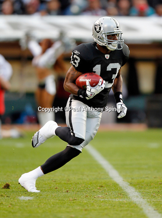 Oakland Raiders kick returner Yamon Figurs (12) returns a kick during the NFL preseason week 3 football game against the San Francisco 49ers on Saturday, August 28, 2010 in Oakland, California. The 49ers won the game 28-24. (©Paul Anthony Spinelli)