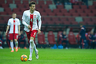 Poland's Lukasz Szukala controls the ball during international friendly soccer match between Poland and Scotland at National Stadium in Warsaw on March 5, 2014.<br /> <br /> Poland, Warsaw, March 5, 2014<br /> <br /> Picture also available in RAW (NEF) or TIFF format on special request.<br /> <br /> For editorial use only. Any commercial or promotional use requires permission.<br /> <br /> Mandatory credit:<br /> Photo by © Adam Nurkiewicz / Mediasport