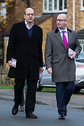 © Licensed to London News Pictures . 17/11/2014 . Kent , UK . UKIP candidate Mark Reckless (left) with UKIP deputy leader Paul Nuttall (right) canvassing votes in Strood in the Rochester and Strood by-election . They meet Fatima Macaulay (right) who says she's voting UKIP . Photo credit : Joel Goodman/LNP