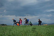 March 3, 2016, Idomeni, Greece. Refugees from Syria and Irak walk to the Idomeni border crossing in Greece. 12.000 refugees are stuck here  after Macedonia closed the border.  New arrivals come in every day.(Steven Wassenaar/Polaris)